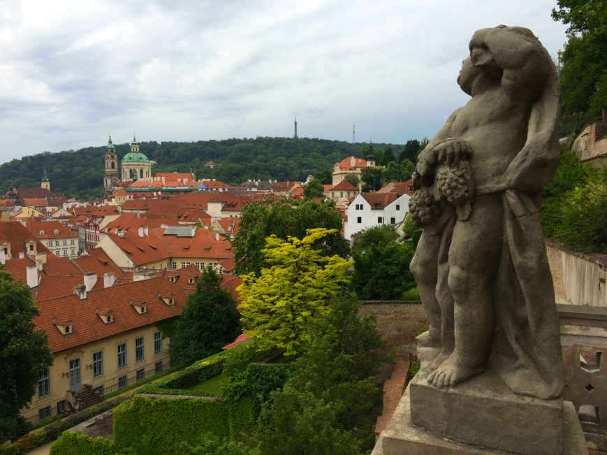 Weary cherub overlooking Prague